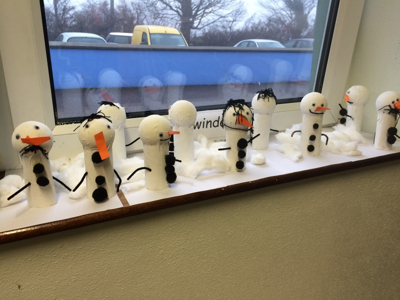 We made a winter wonderland full of snowmen on the windowsill!